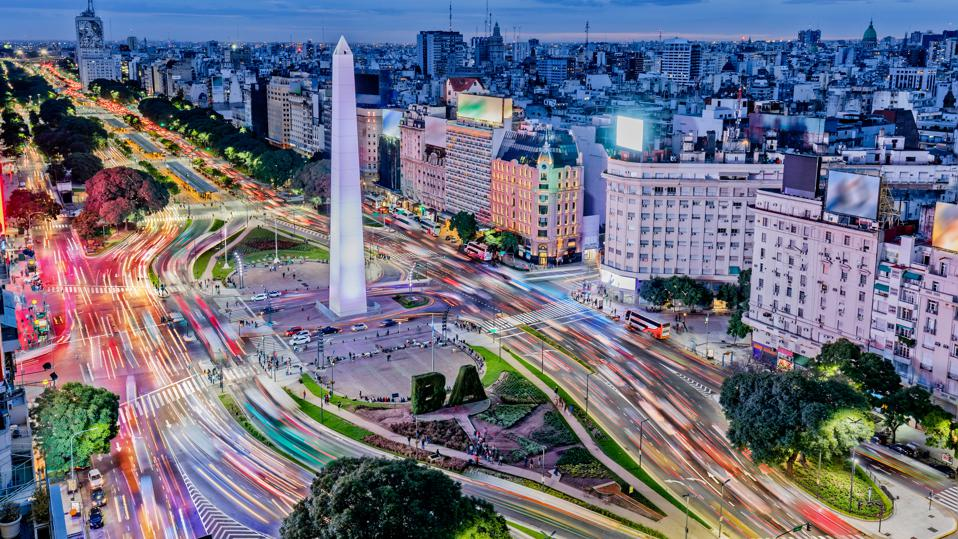 Argentina Buenos Aires downtown with traffic cars at night arround the Obelisco