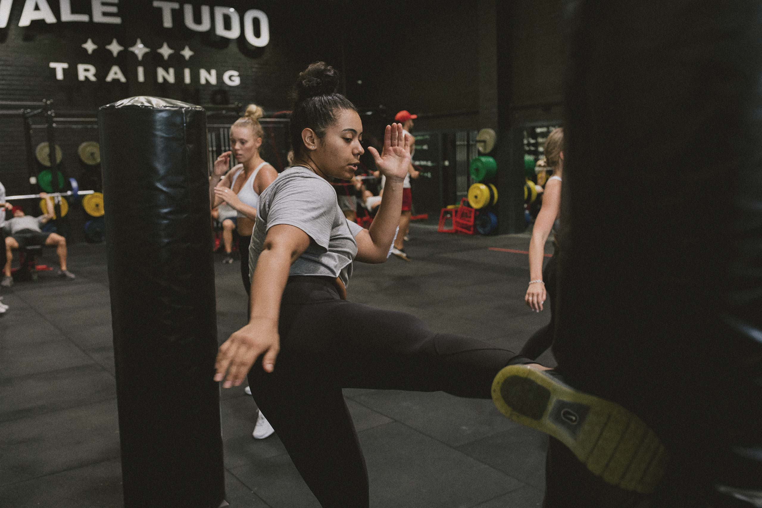 female athlete training kickboxing and mixed martial arts