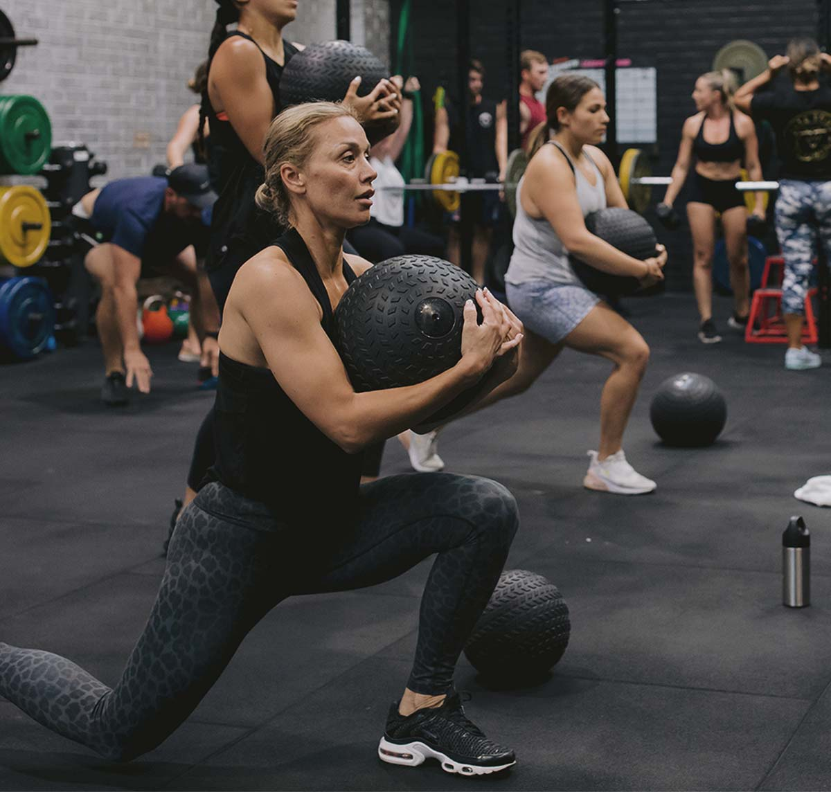 Woman working out lifting medicine ball