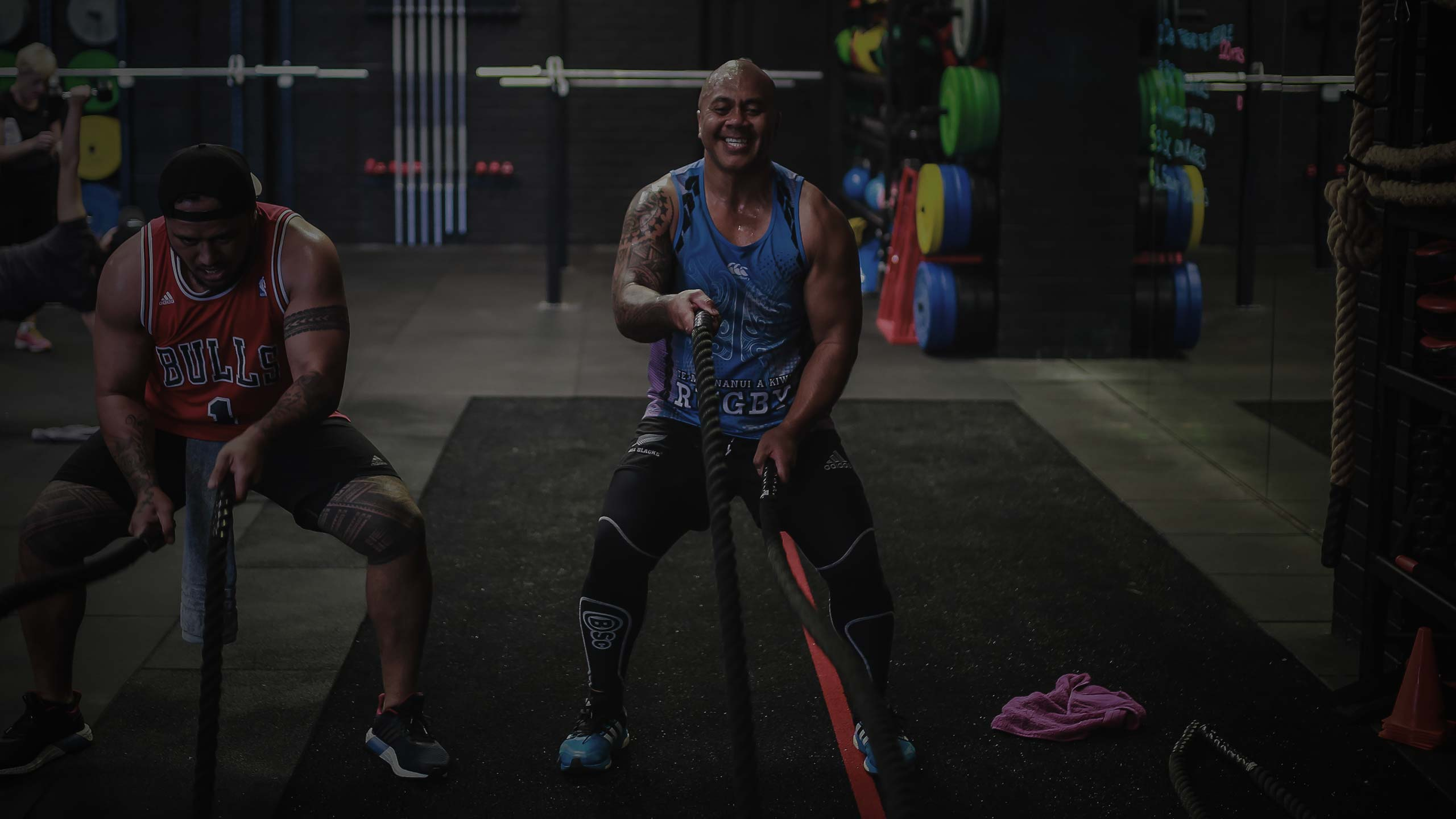 male athlete training with battle ropes
