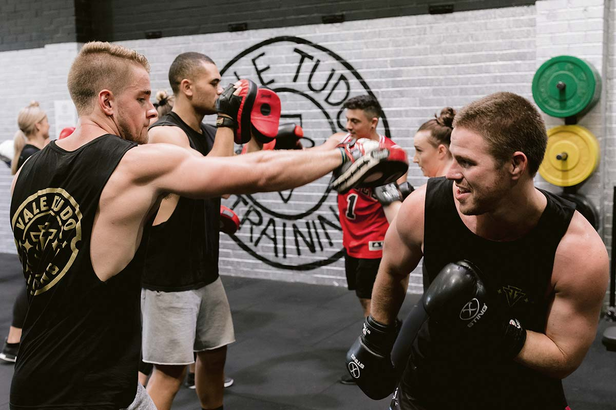 male athletes sparring in boxing training exercise