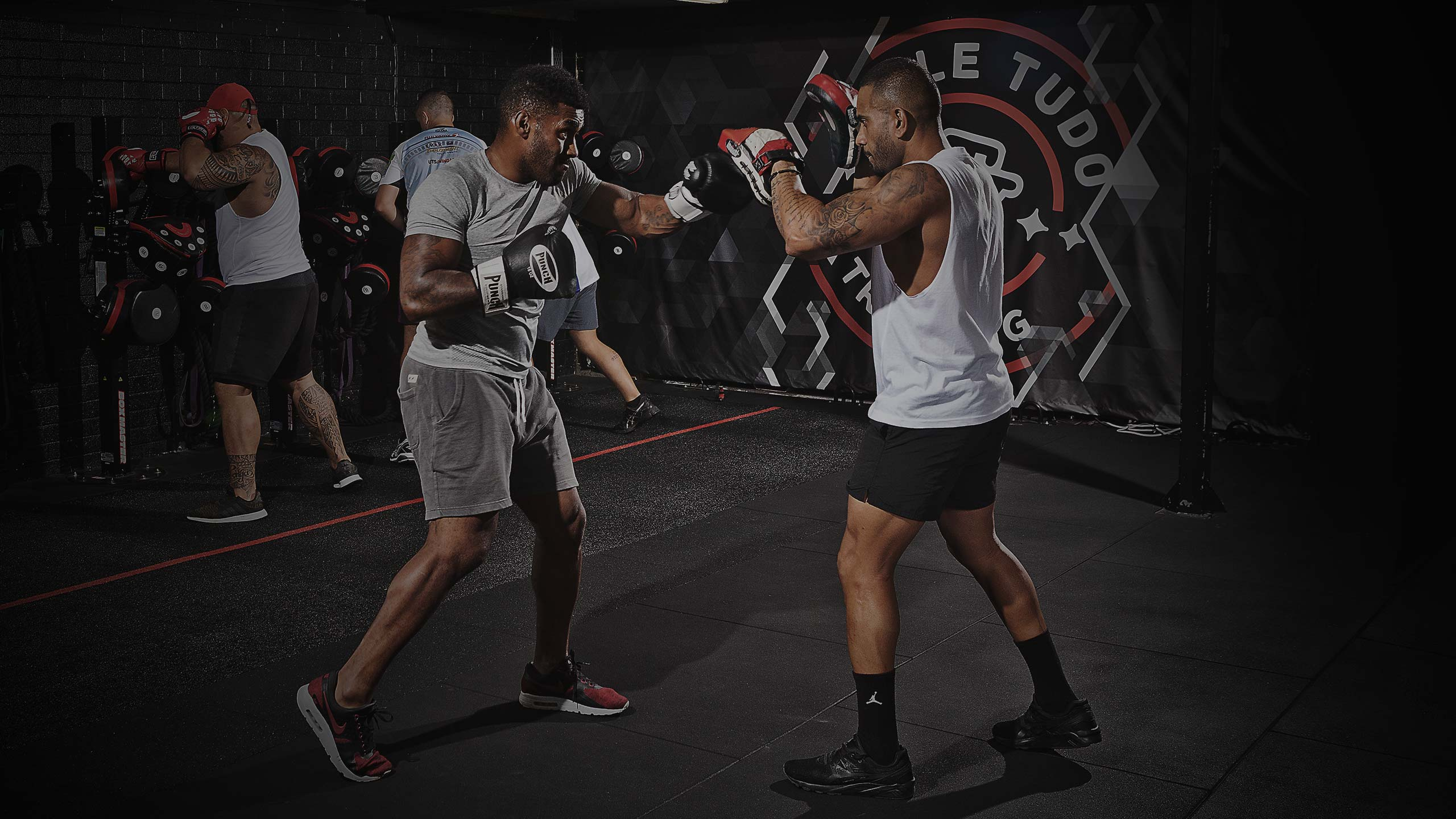 pair of male athletes boxing and training sparring