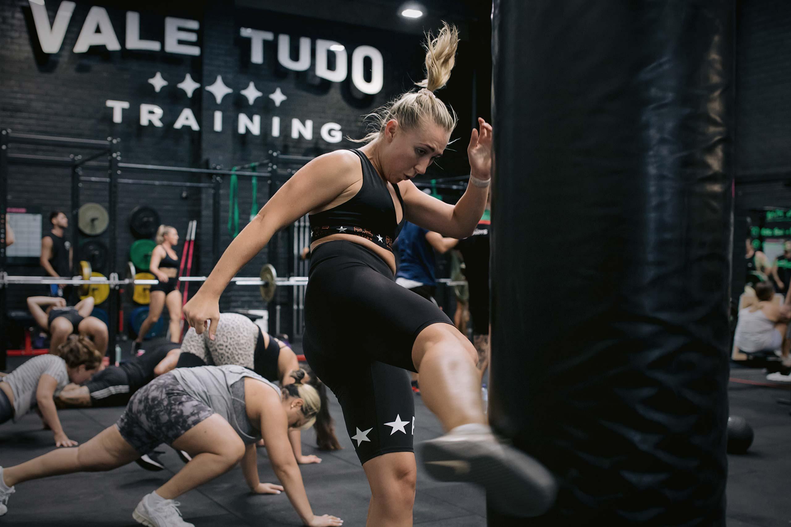 female athlete training kickboxing and mixed martial arts
