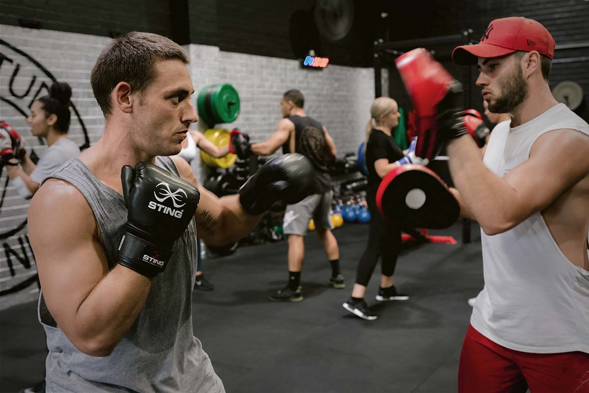 male athletes training boxing sparring