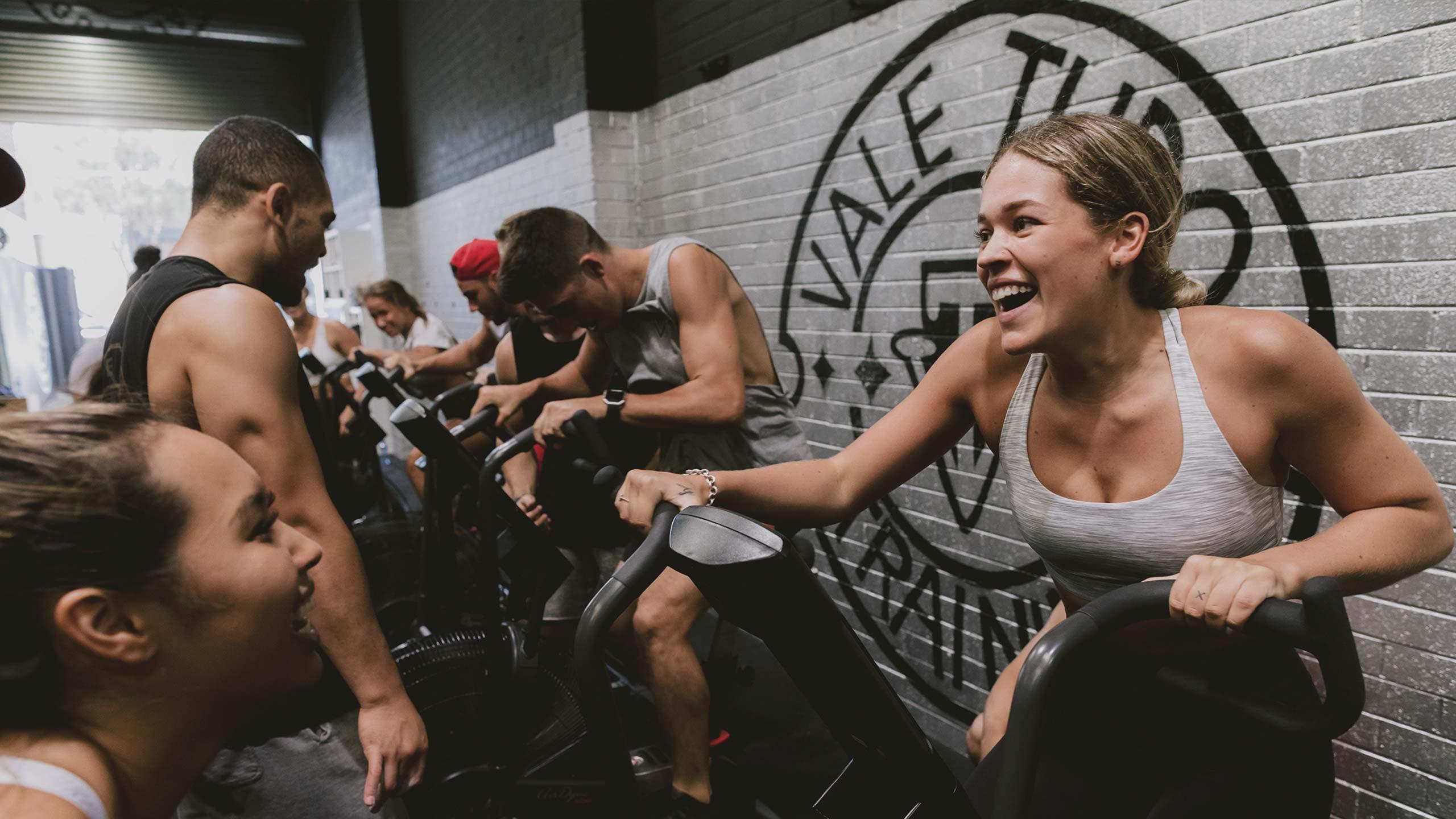 women smiling on crosstrainer in vale tudo unleash program