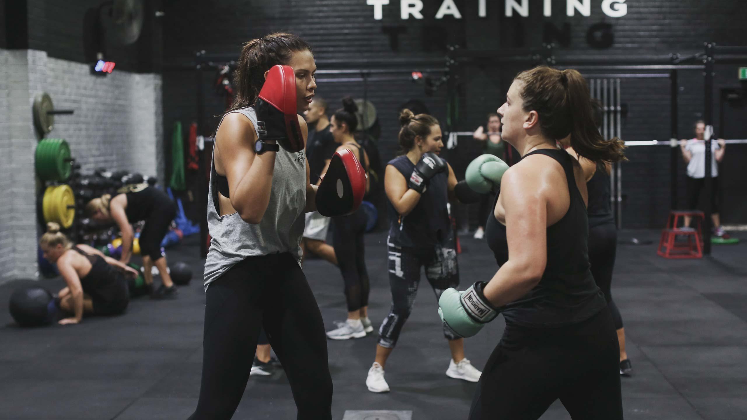 women training boxing exercises in vale tudo unleash program