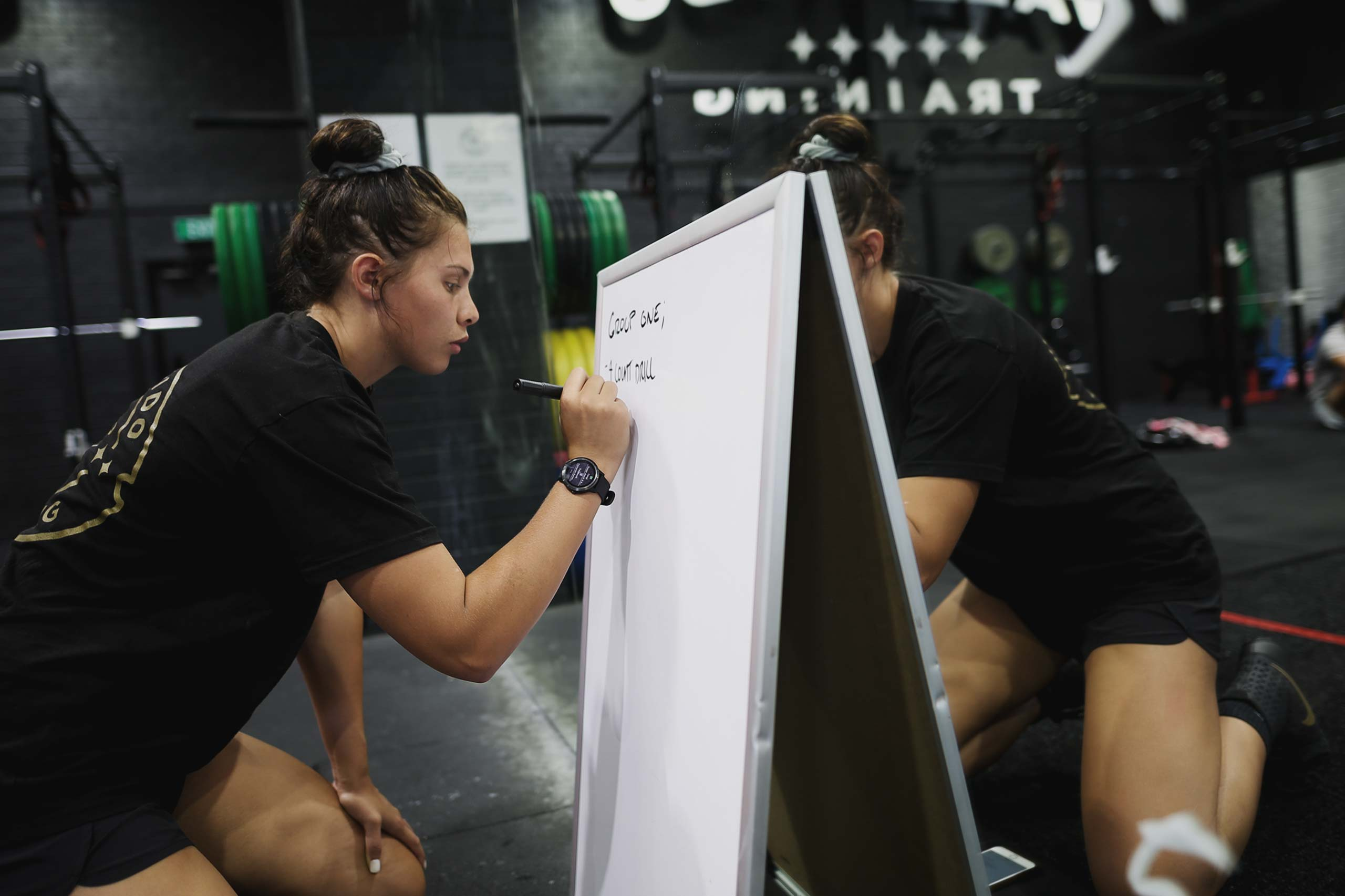 che kenneally writing on whiteboard at vale tudo training