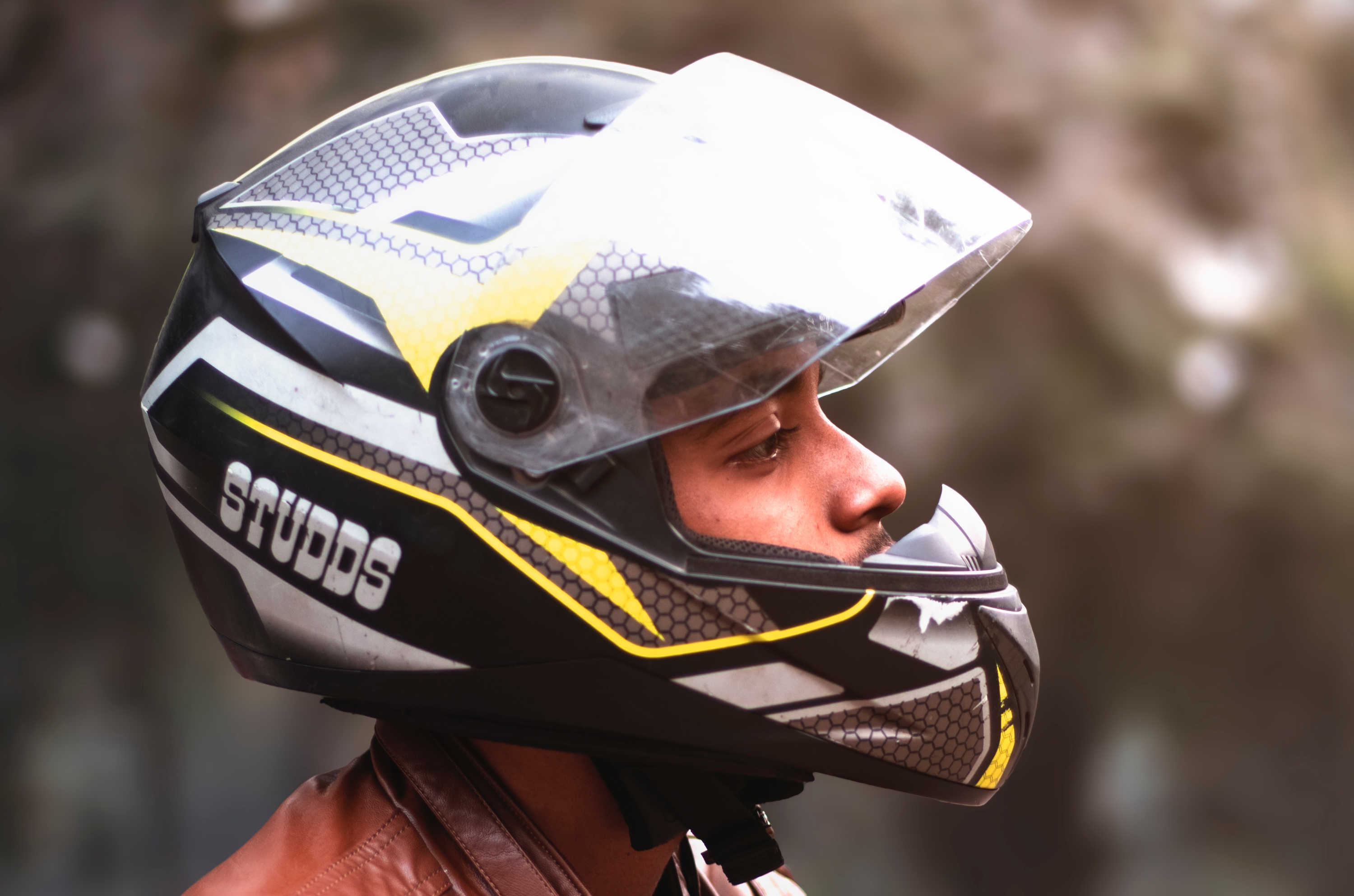 A man wears a full-face motorcycle-style helmet, which are safer at high speeds but reduce peripheral vision.