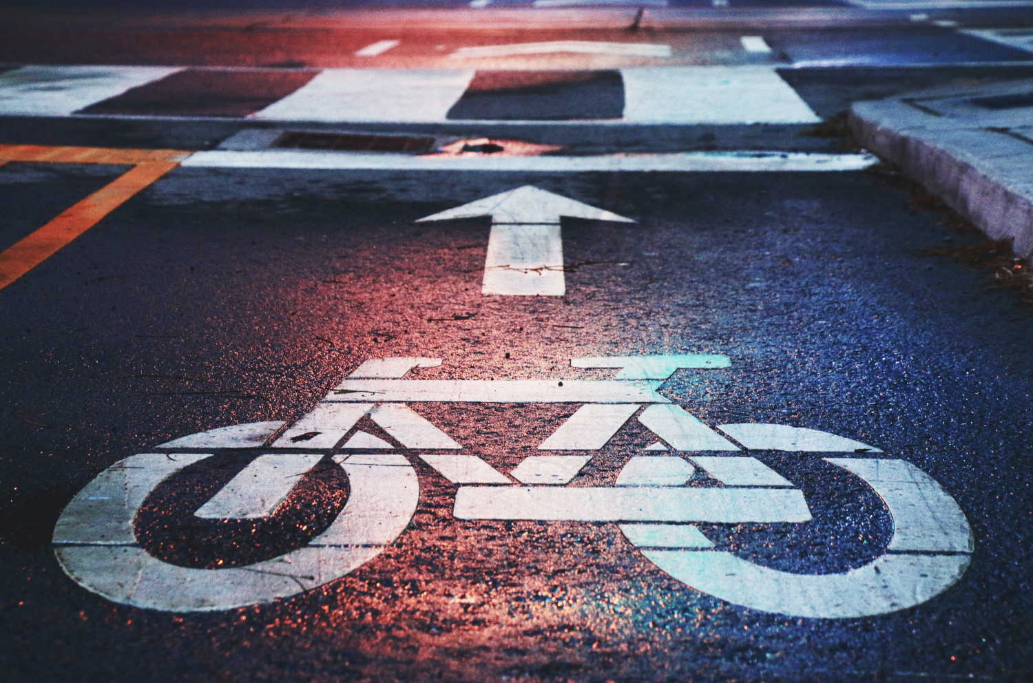 A closeup of a bike symbol, designating a section of the road as a cycle lane.