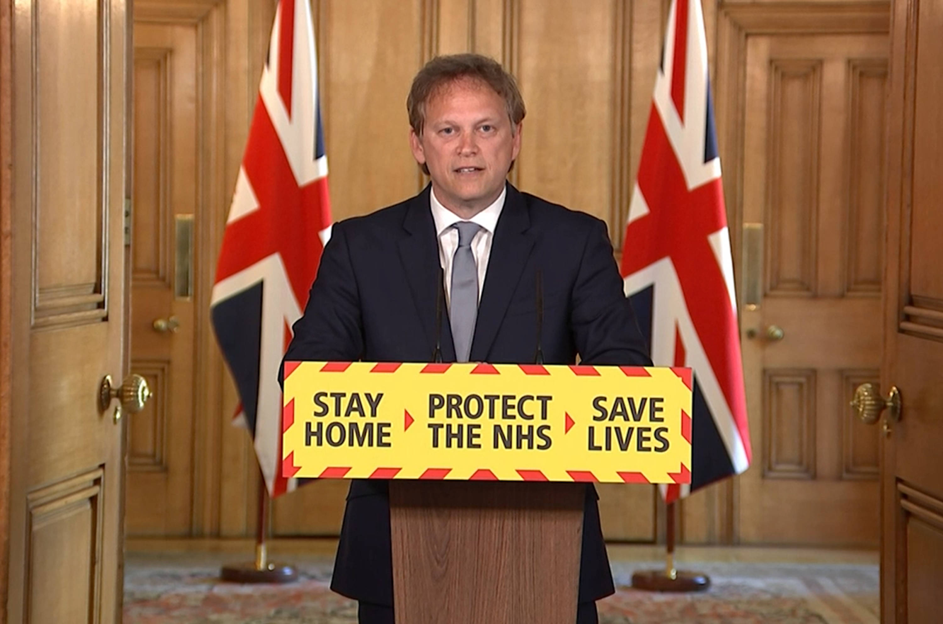 UK Transport Secretary Grant Shapps presents at the No.10 lectern for the daily Downing Street briefing