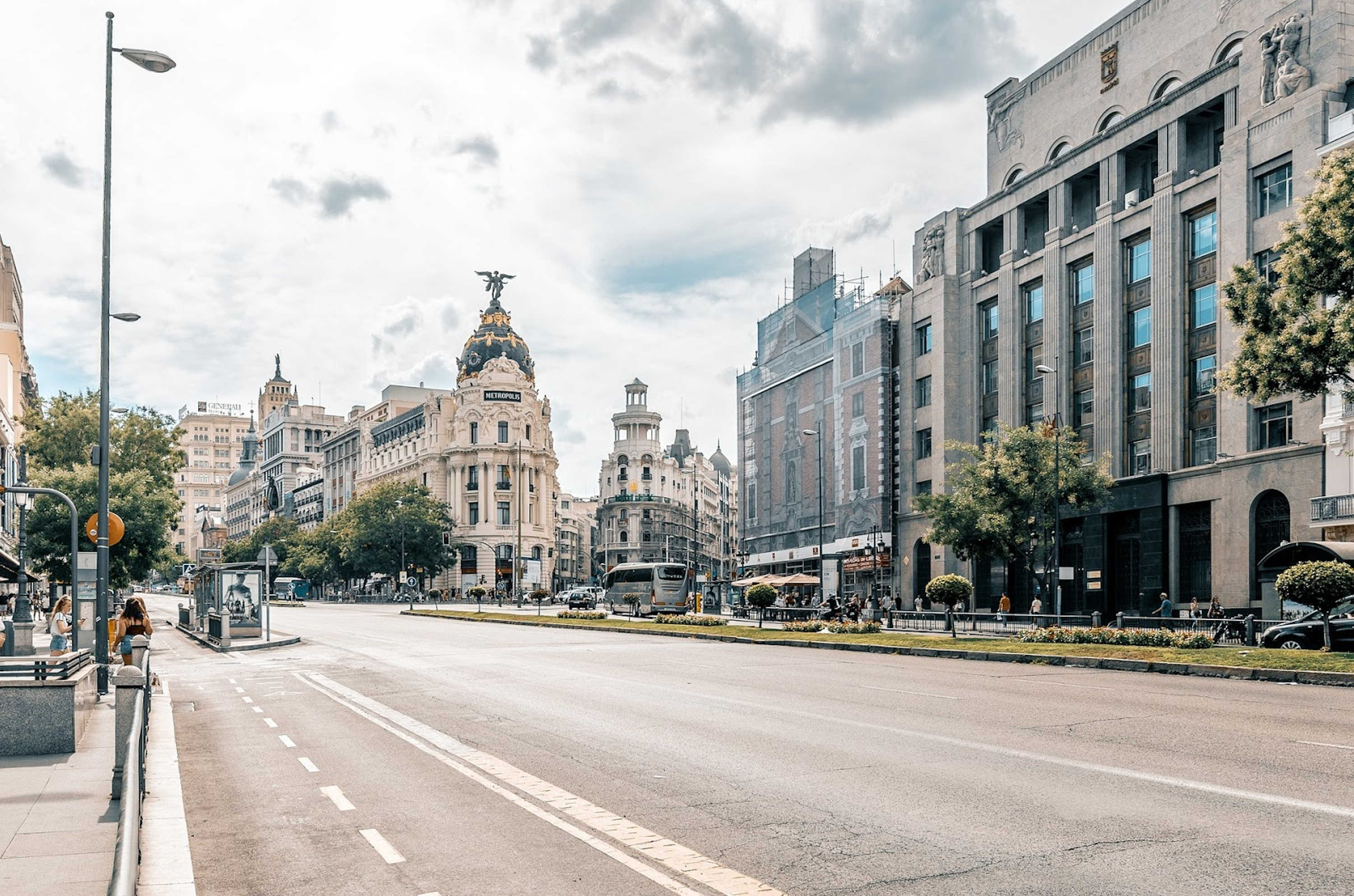 An almost empty street with a two-way bike lane in the city centre of Madrid.