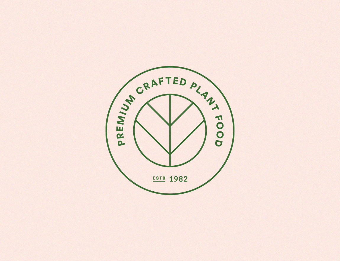 Nelson Plant Food logobadge green on pink
