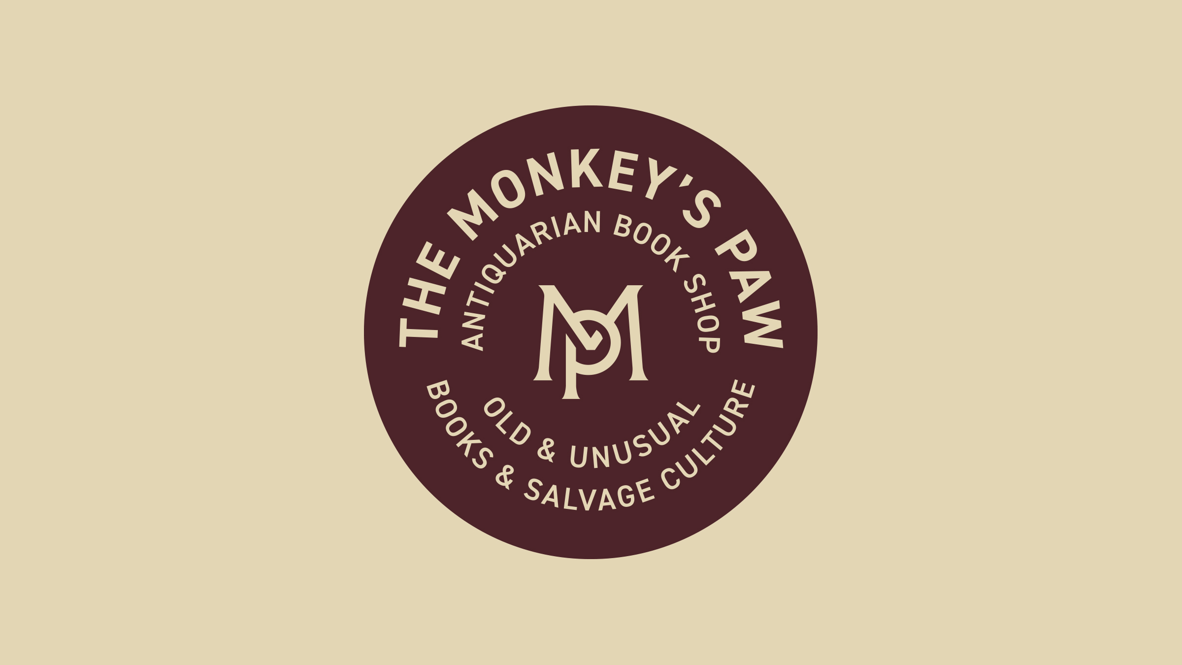 The Monkey's Paw brand logobadge maroon on cream