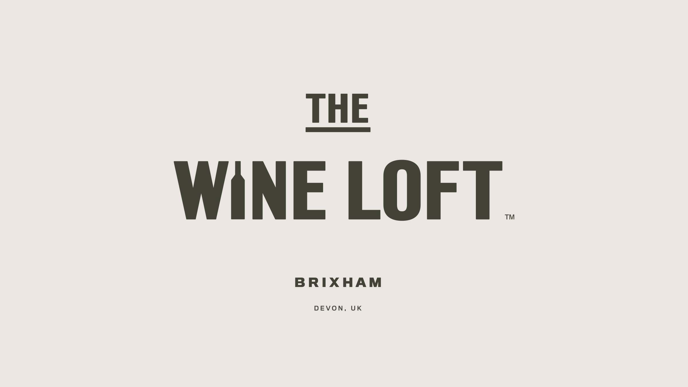 The Wine Loft brand logo green on cream
