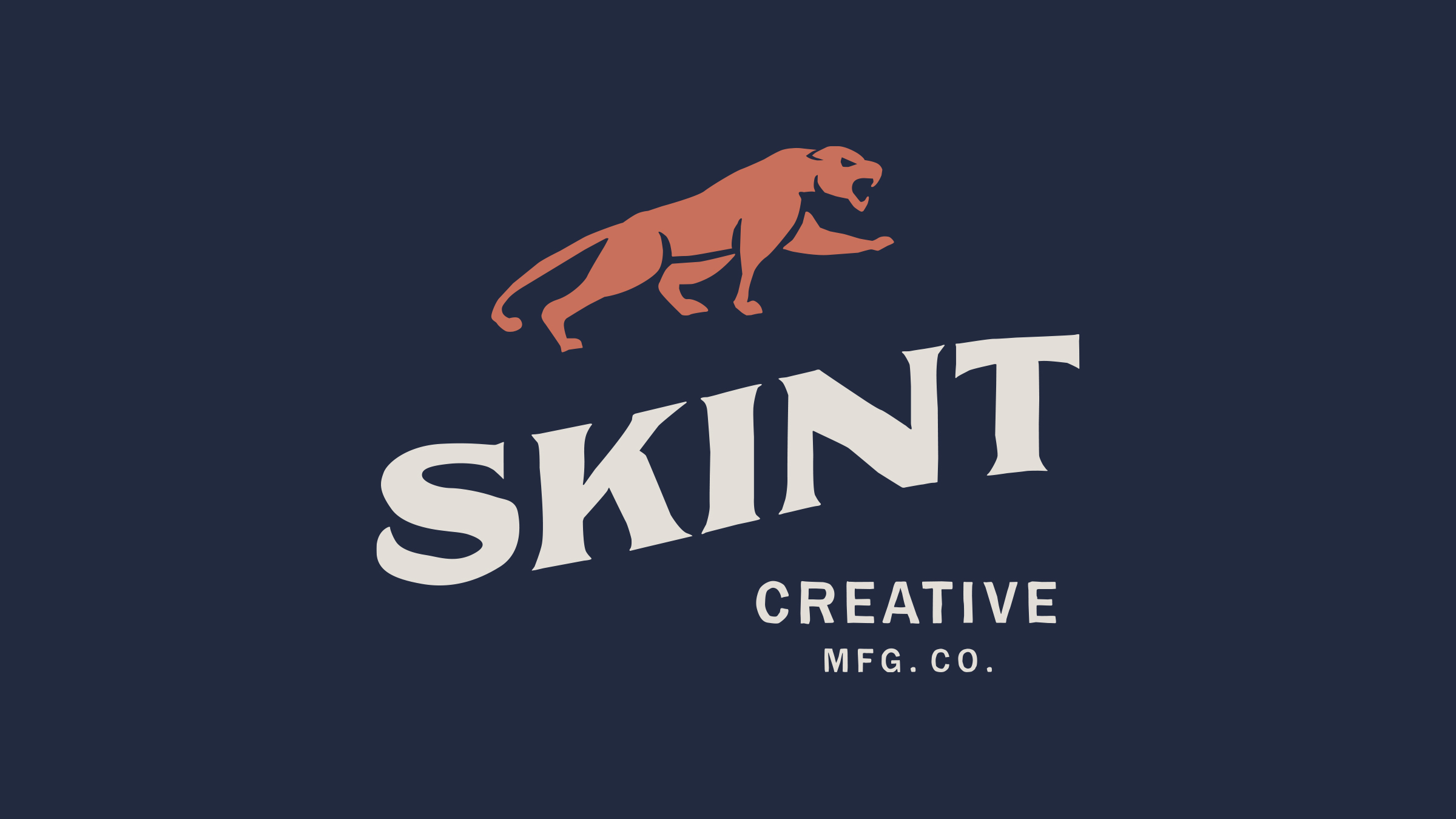 Skint Creative brand logo cream and orange on blue