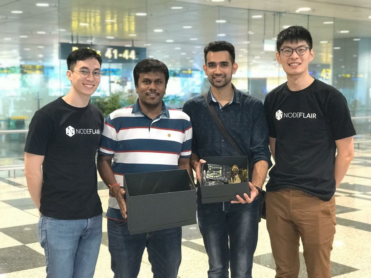 KC (left), a talent advocate picking up developers at Changi Airport to accompany them to their accommodations