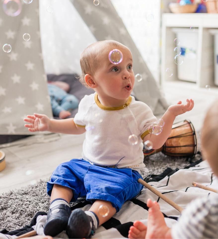 infant blowing bubbles