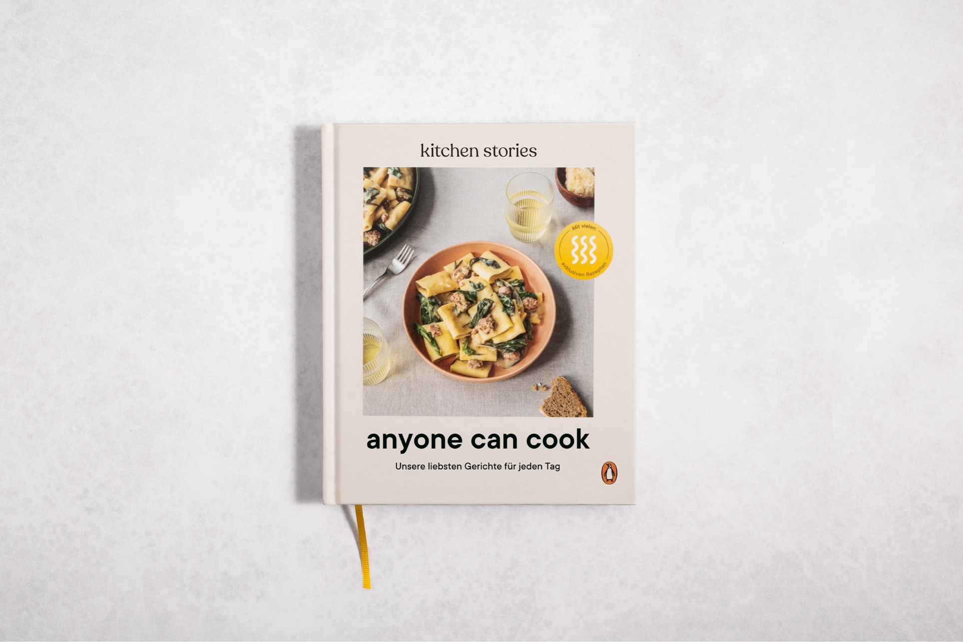 """The cover of a cookbook titled """"Anyone Can Cook"""" by Kitchen Stories"""