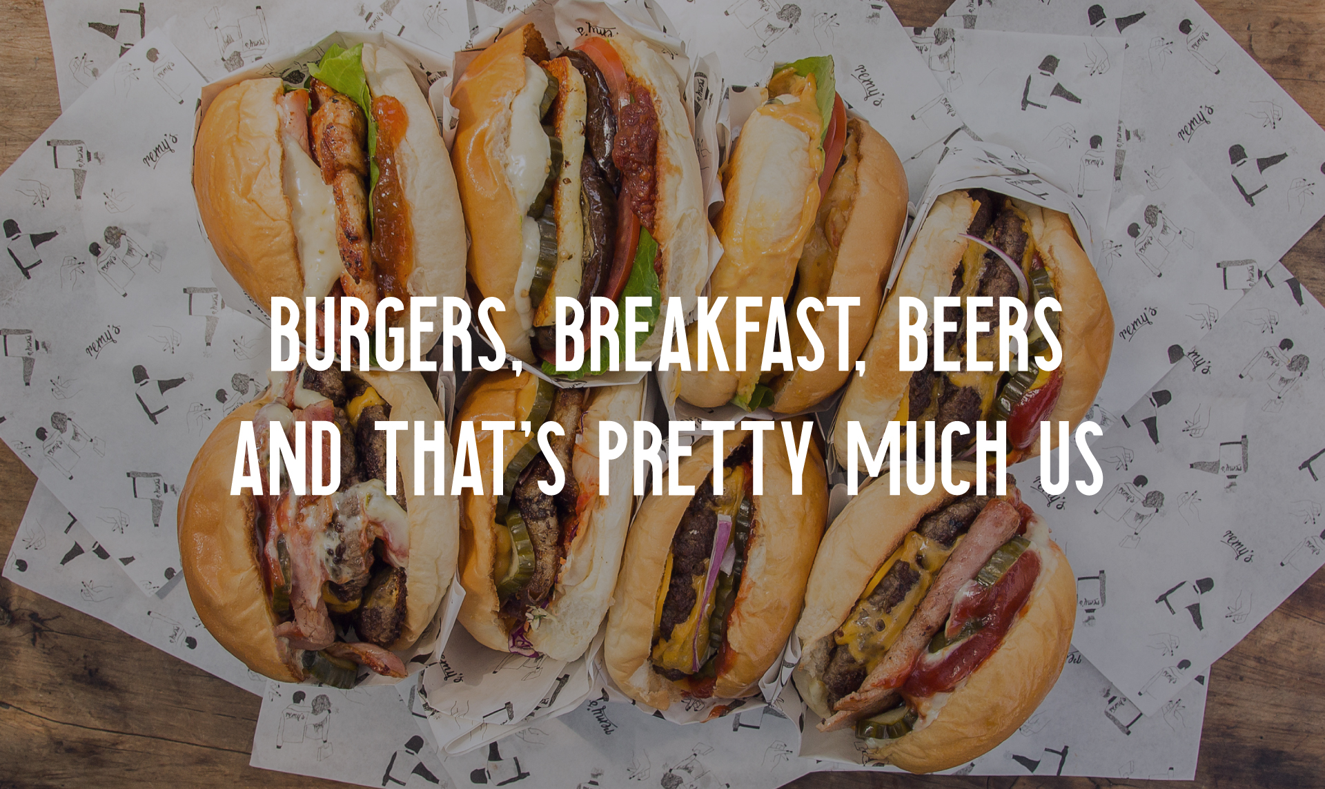 A range of meat & veggie burgers with a text overlay reading 'burgers, breakfast, beers and that's pretty much us'