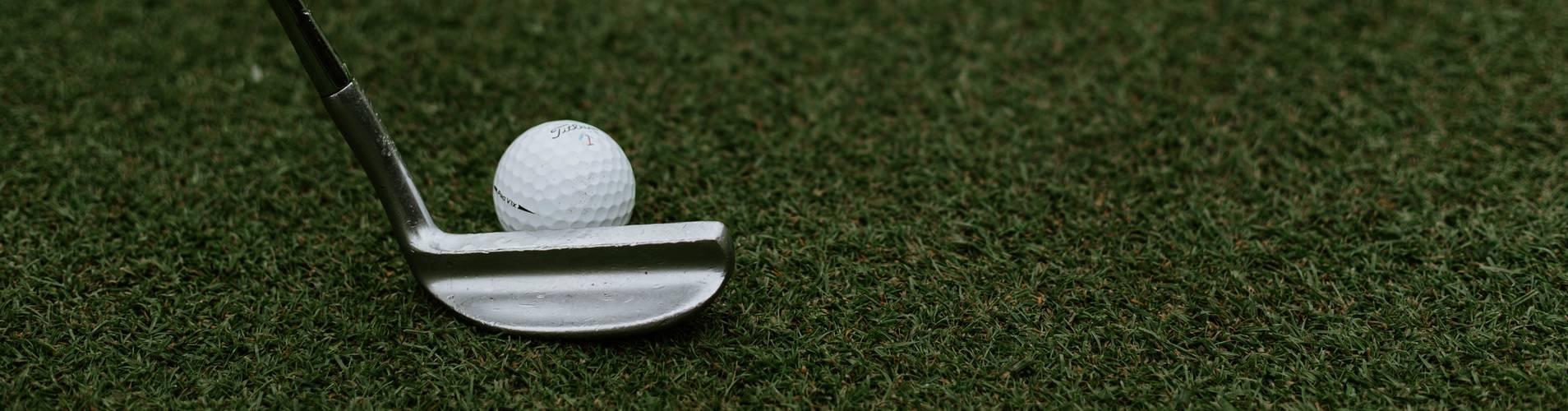 putter next to golf ball