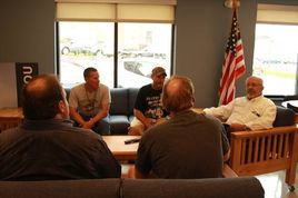 group of 5 male veterans in discussion group