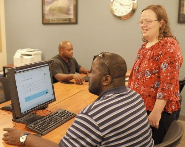 City Mission's Career Training & Education Center manager provides instruction to a job searcher