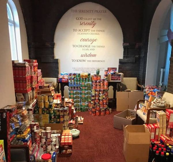 Canned and dry goods pile up in a Chapel adjacent room