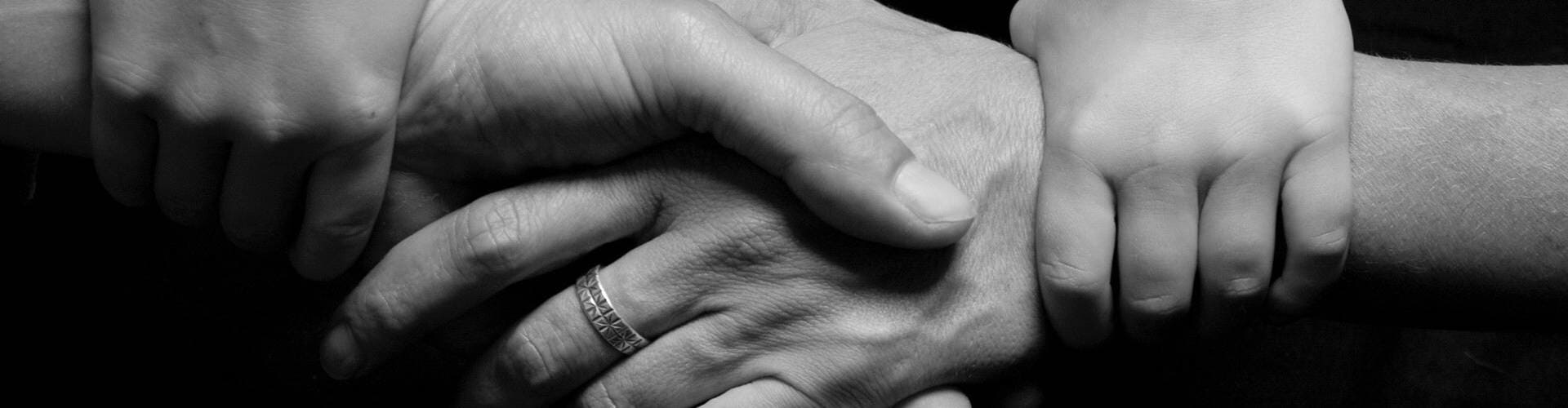 Hands being held in the spirit of giving