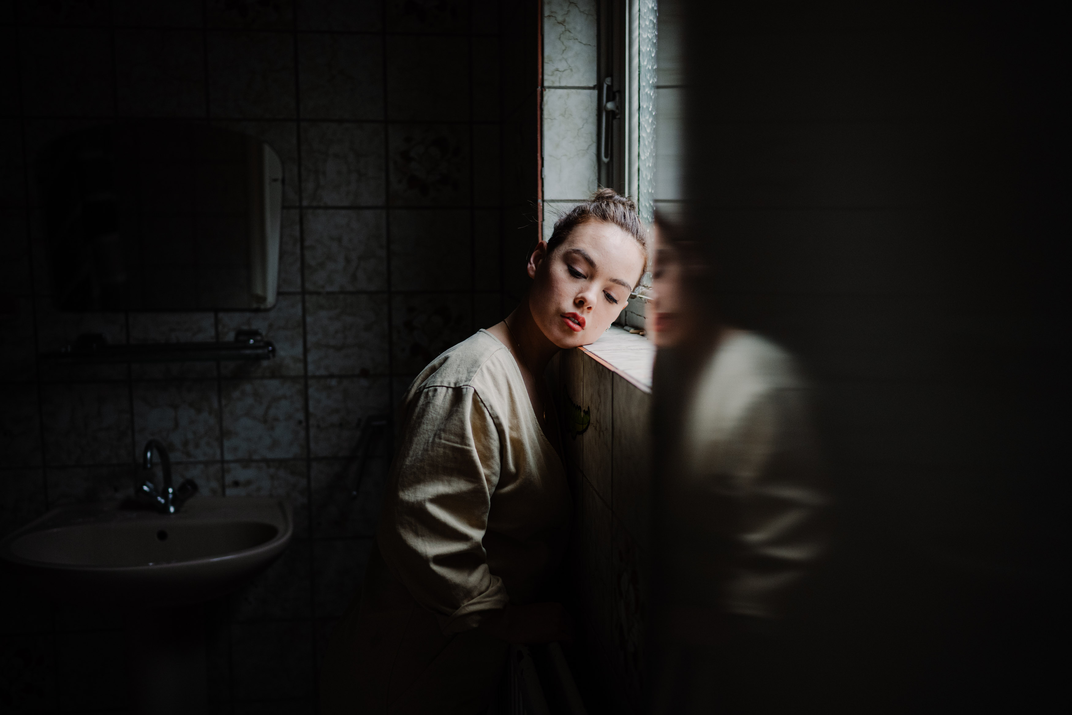 cinematic portrait in bathroom
