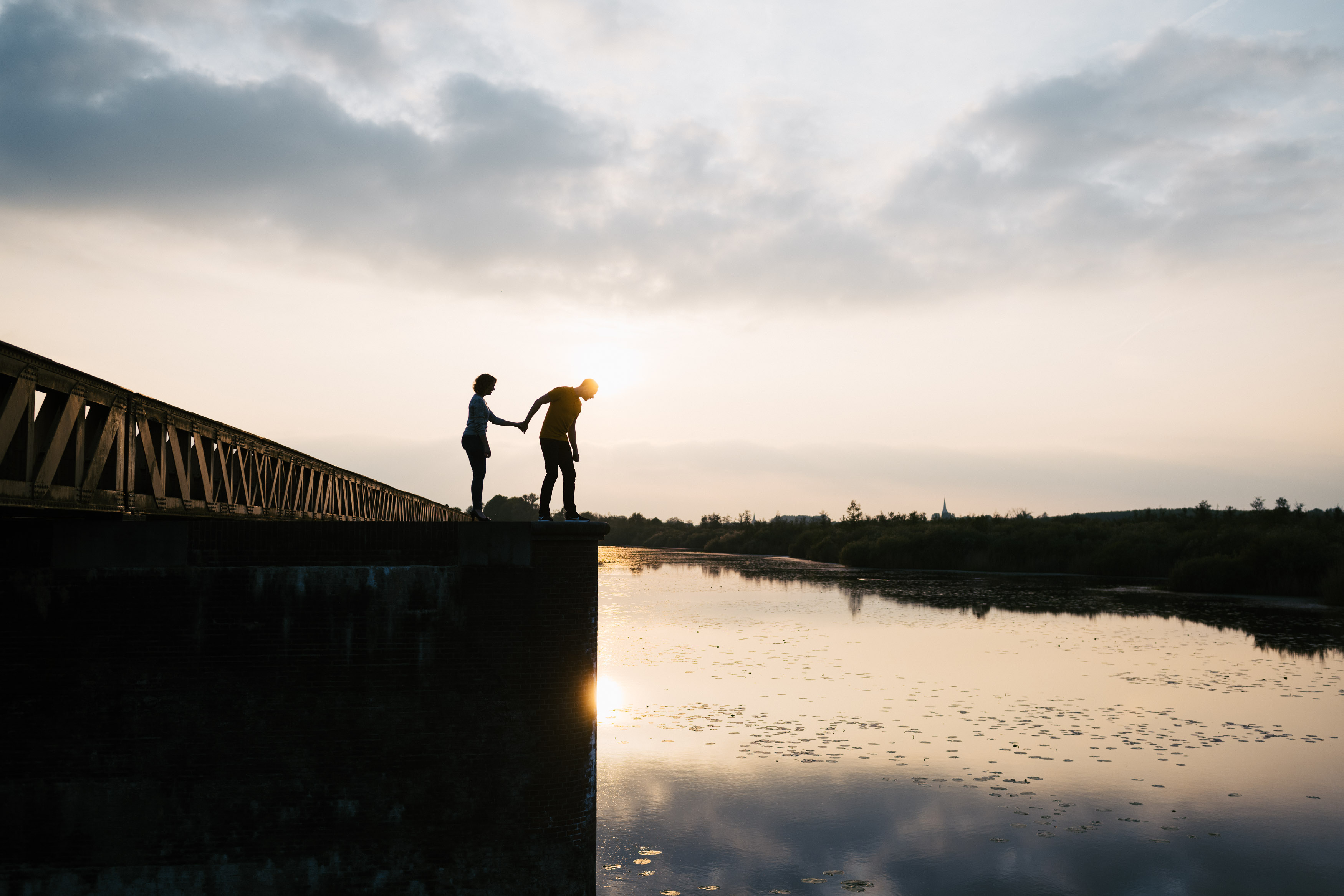 couple overlooking water at sunset