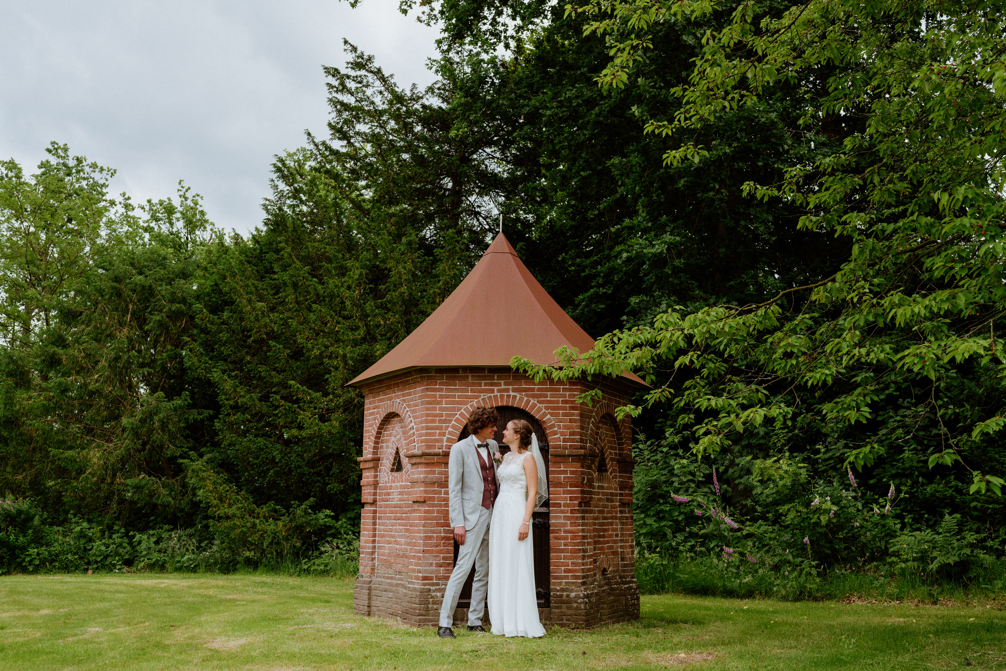 wedding couple in front of tower