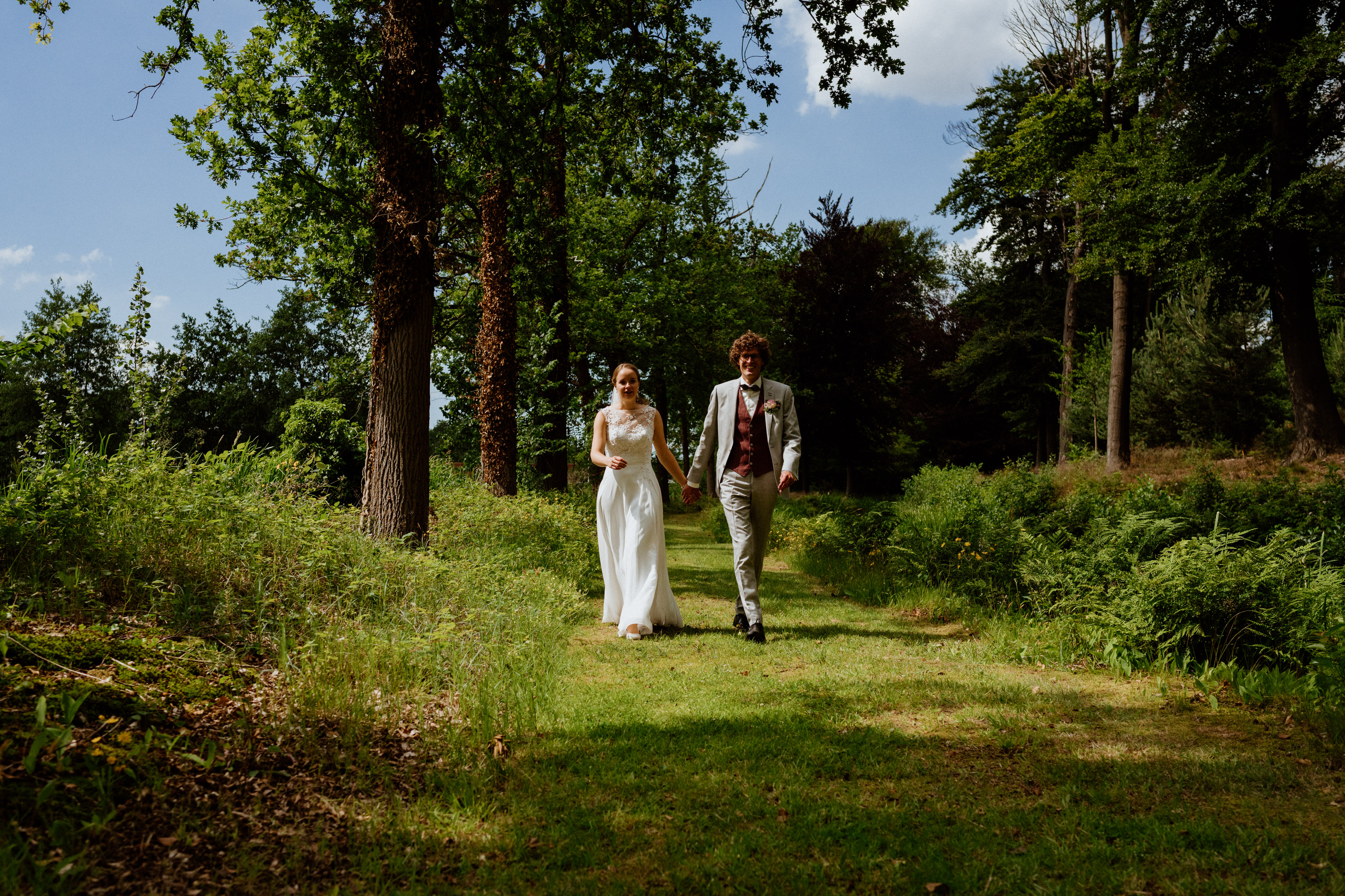 wedding couple on sunny day in forest
