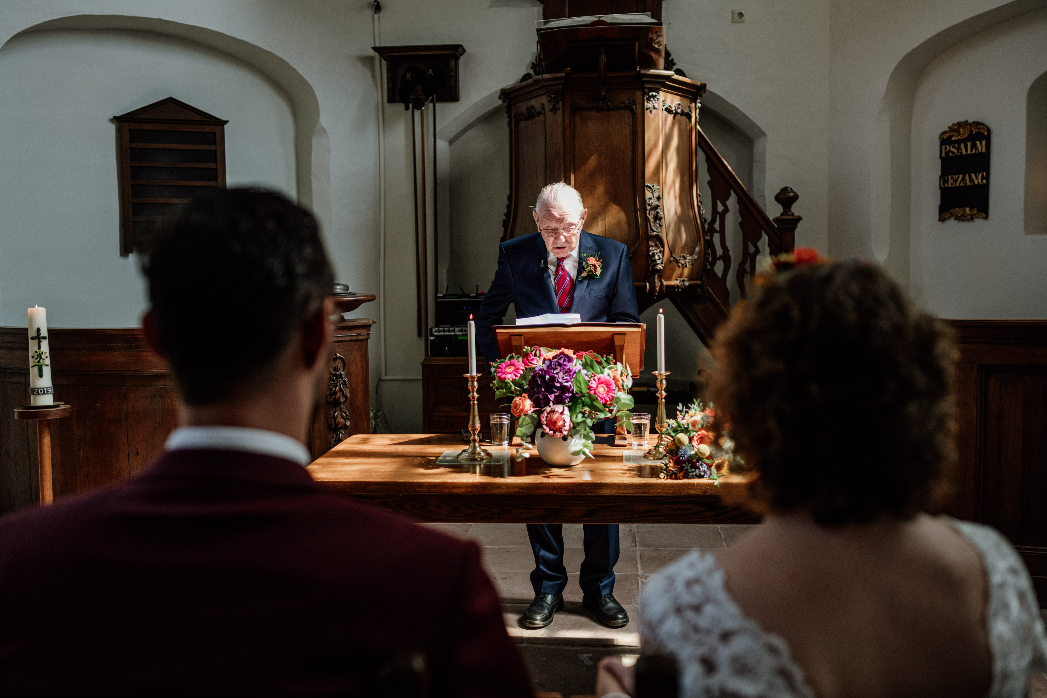 grandfather with wedding couple in church