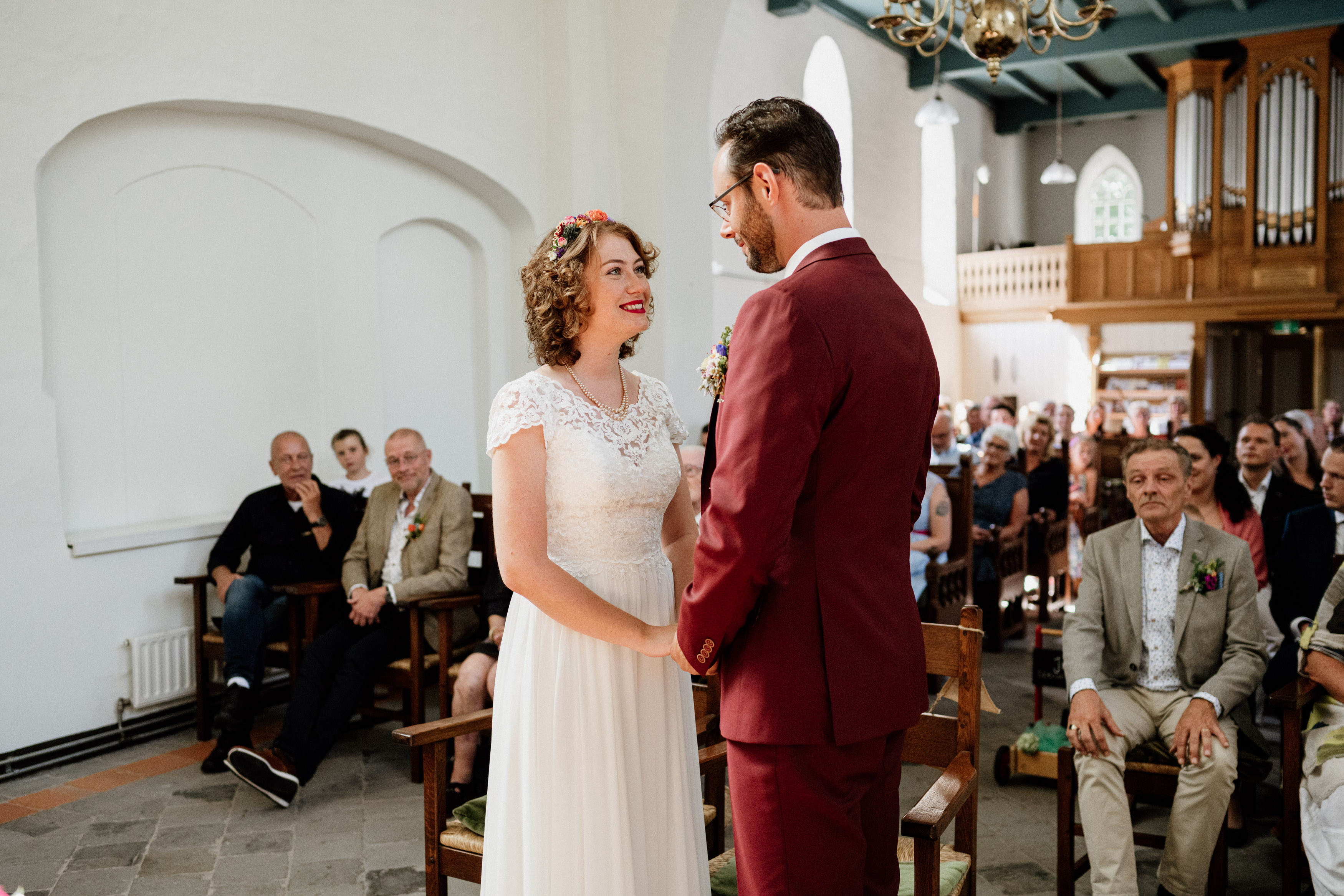 wedding couple in church in front of people