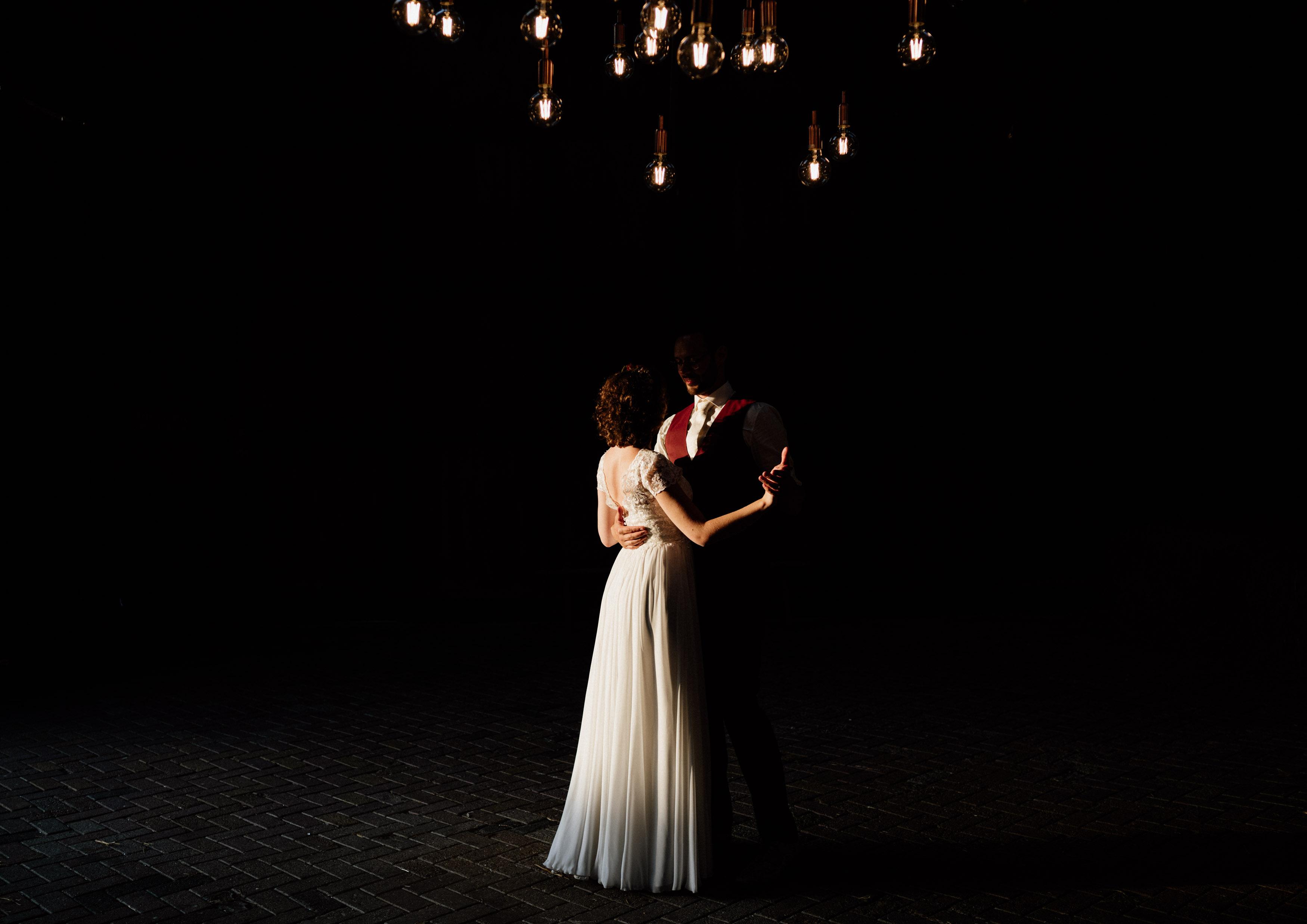 wedding couple in cinematic dark barn