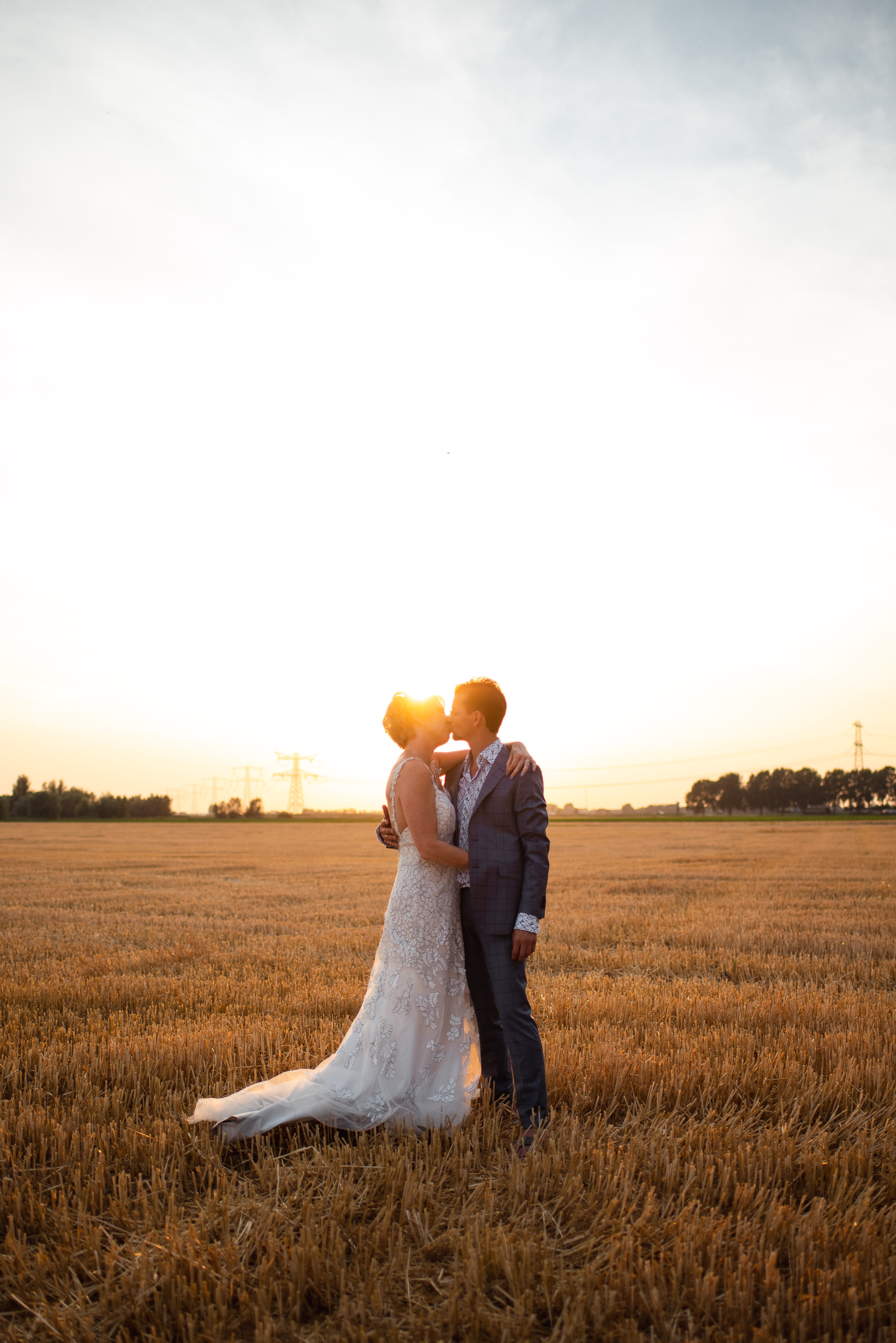 wedding couple portrait with sunset
