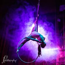 an aerialist performs and does the splits