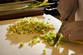 a chef preparing chopped vegetables