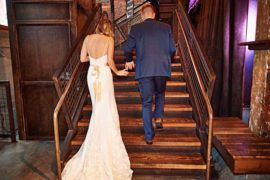 newlyweds ascend stairs out of melrose market studios