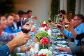 a table full of guests dining and drinking together