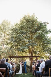 an outdoor wedding ceremony held in a private garden