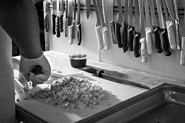 a chef preparing ingredients on a kitchen counter