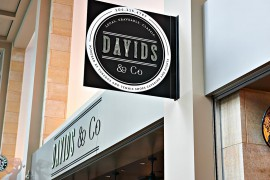 a banner sign display that reads Davids and Co