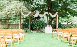 The hall at fauntleroy garnen set for an outdoor wedding ceremony