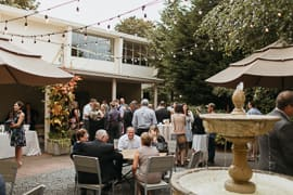 Guest mingling during an outdoor reception in a courtyard