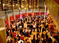 A large crowd of attendees at an event in Benaroya Hall's grand lobby