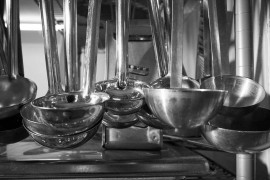 assorted ladles handing in a kitchen