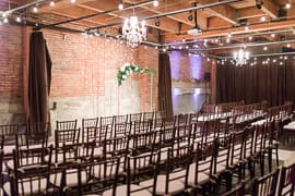 an empty wedding ceremony set with chairs and an altar