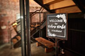 A custom made sign welcomes guest to a wedding venue