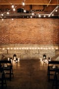 chairs set for a setting ceremony in an underground venue